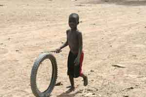 Child With a Tire